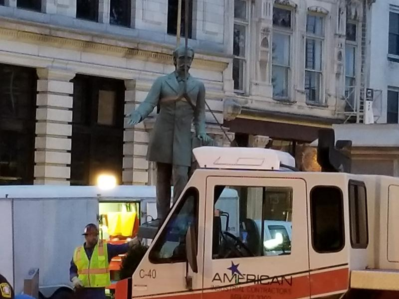 The statues are being moved into storage until an agreement can be finalized with the Lexington Cemetery