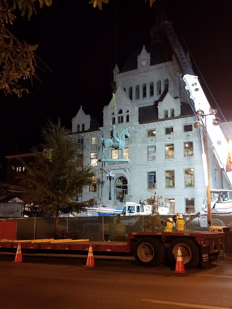 The statue of John Hunt Morgan was loaded onto the trailer shortly after midnight Wednesday
