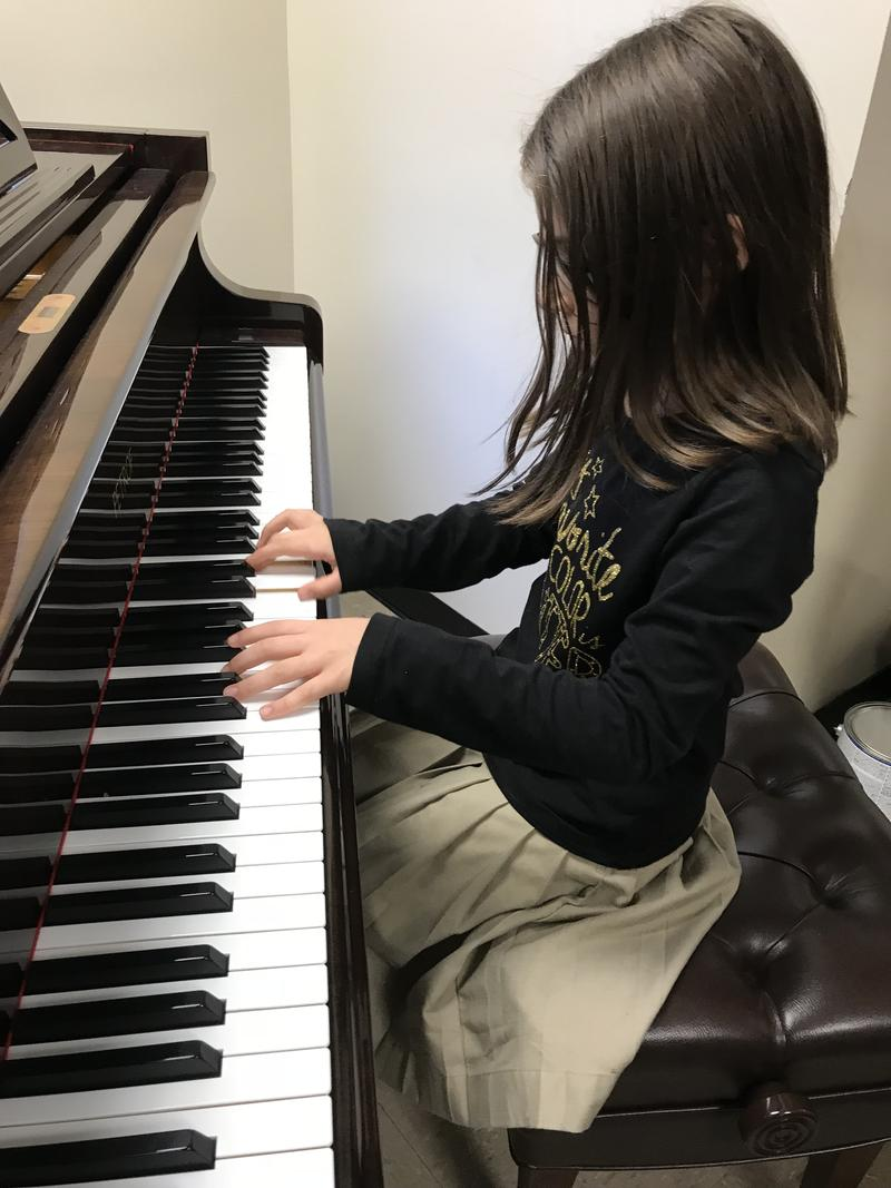 Caeli Doll rehearses for holiday concert