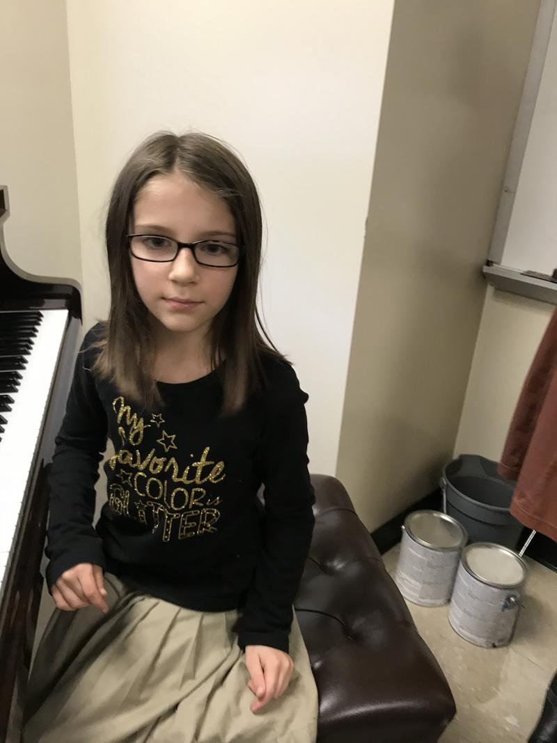 Caeli Doll loves playing piano with F.A.M.E.