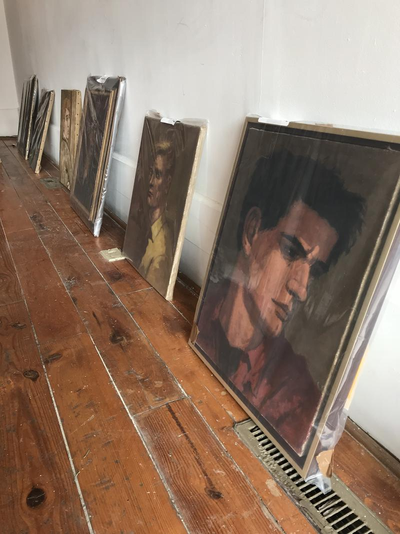 Portraits by Edward Melcarth lined up and ready to be placed in exhibit