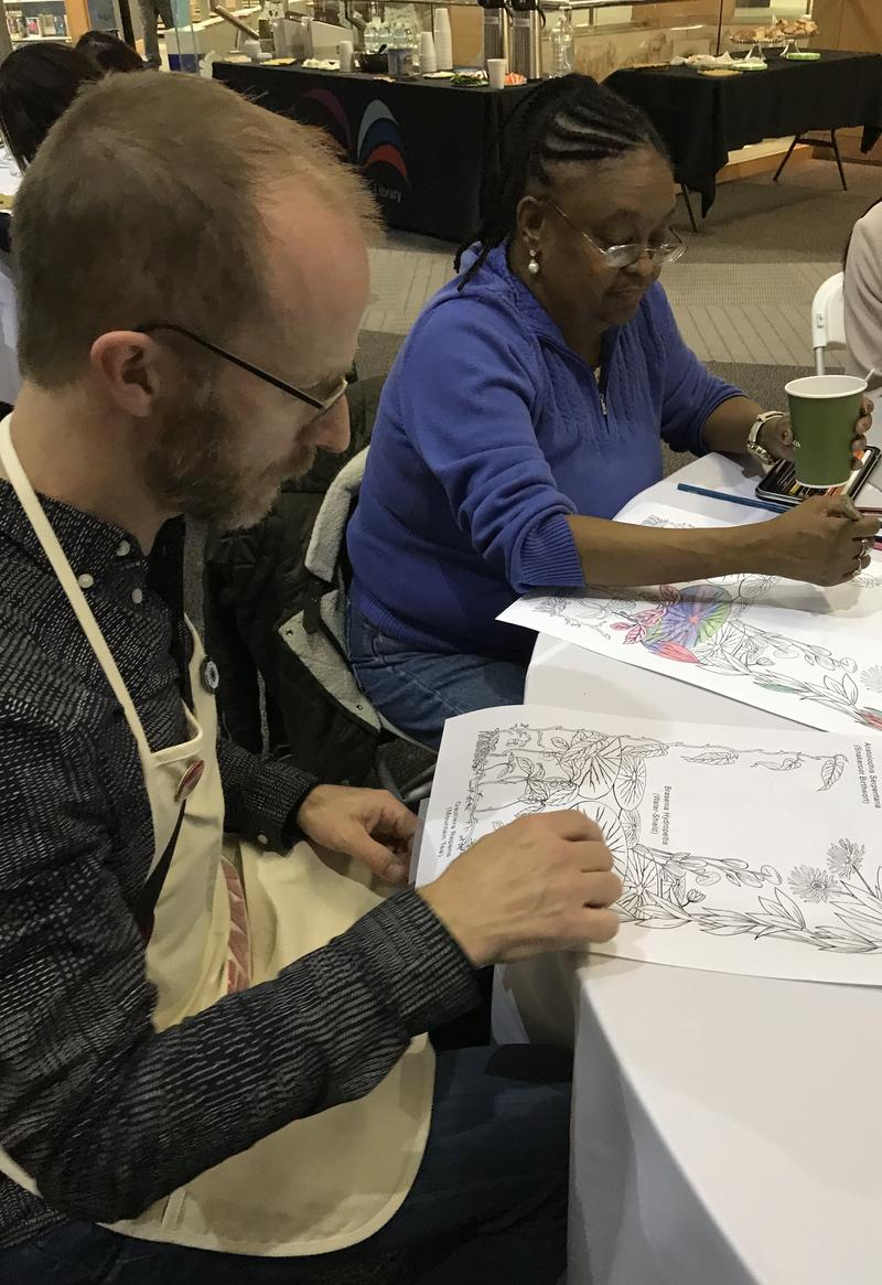 Kurt Gohde and Saunda Coleman color together