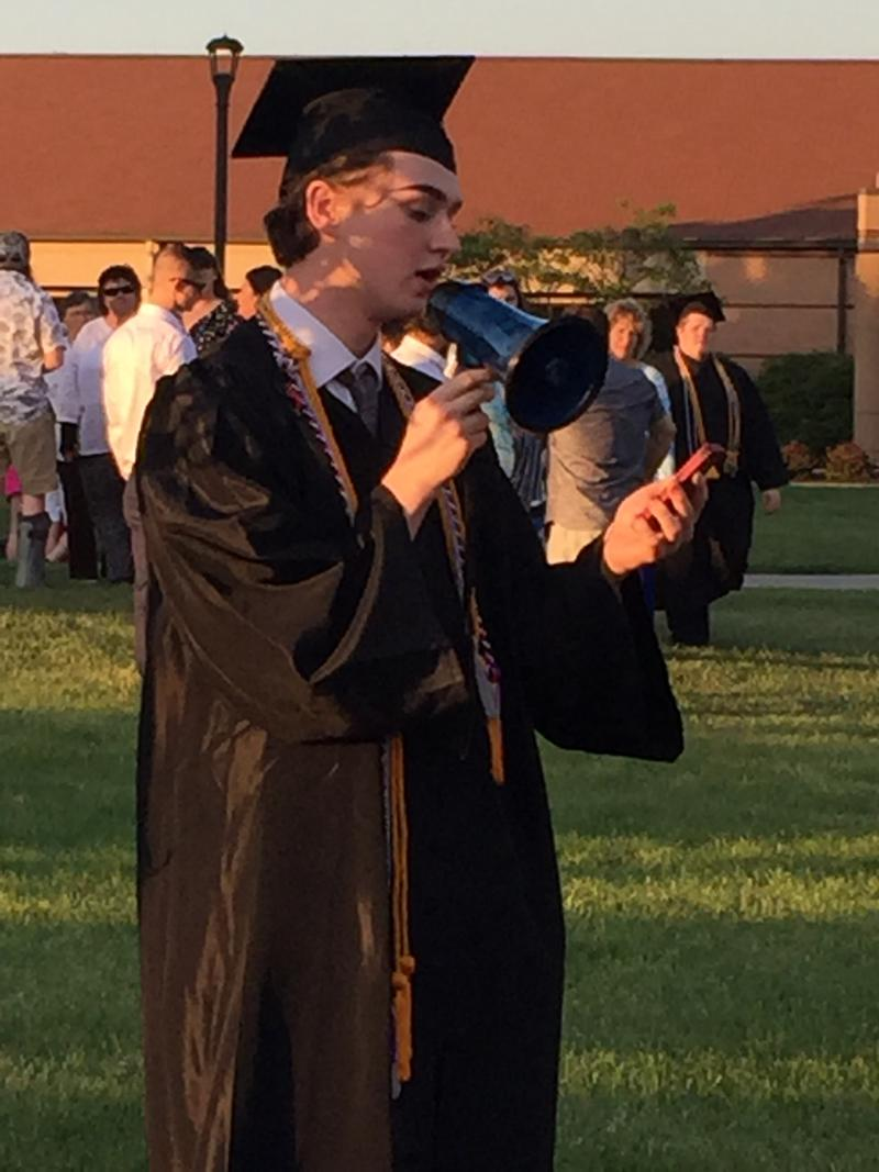 Christian Bales gives his graduation speech outside Thomas Moore College