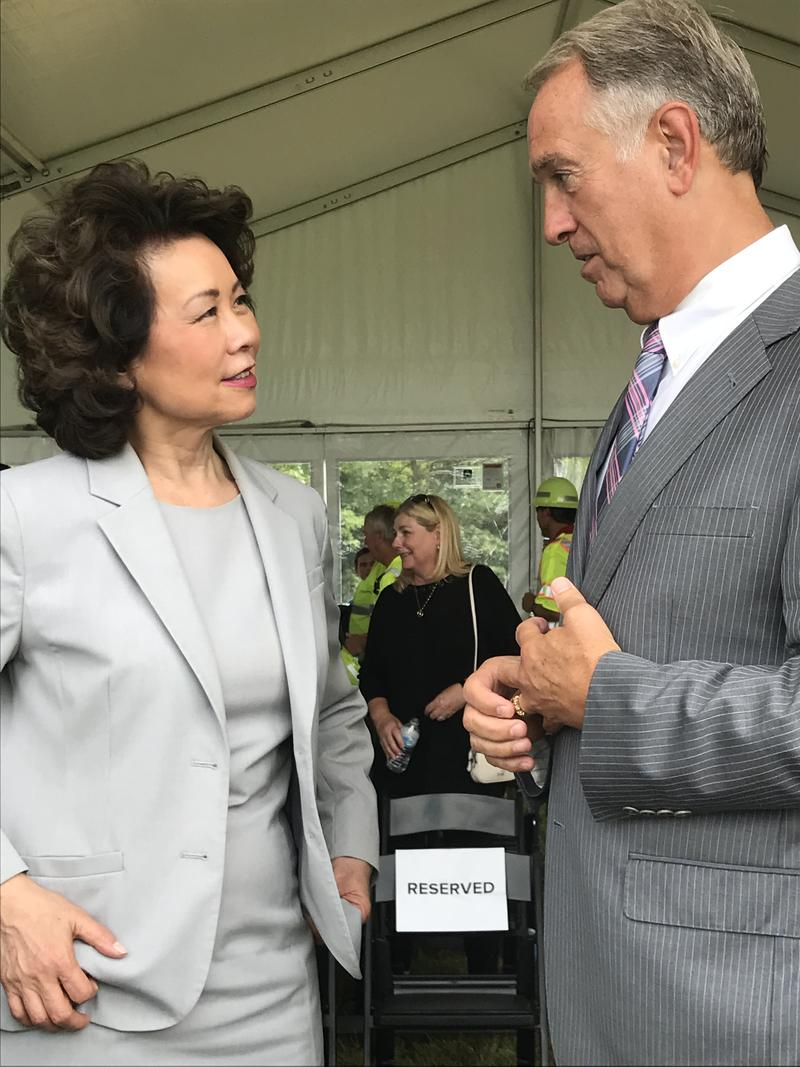 Transportation Secretary Elaine Chao chats with Boone County Judge Executive Gary Moore