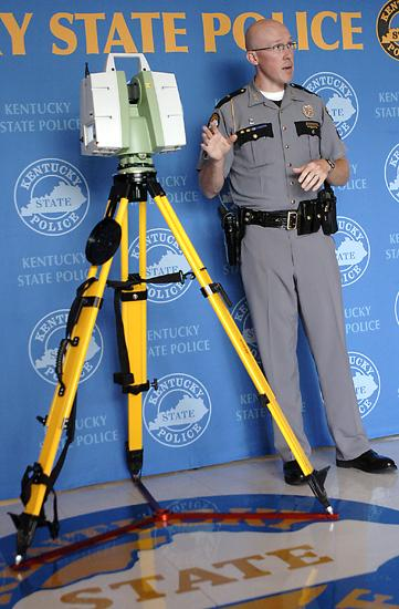 Sgt. Chad Mills of the Kentucky State Police Collision Analysis and Highway Safety Branch talks about the capabilities of the new Leica ScanStation C10 during a press conference at KSP headquarters.
