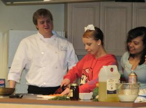 Chef Jeremy Ashby shows students how to prepare carrots for a healthy meal.