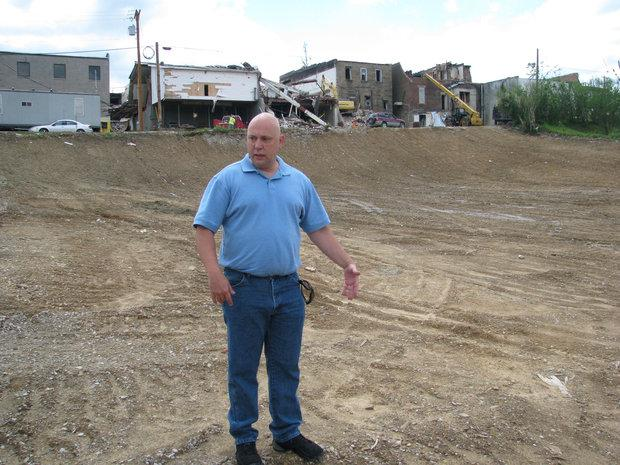 Tim Smedley, 46, a West Liberty police officer, stood on the lot where his house had been before it was demolished in the March 2 tornado that tore through town. Smedley is buying a house.