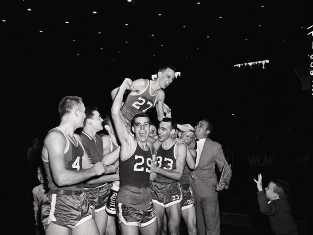 E.A. Couch (33) helped carry Freddie Maggard of Carr Creek after Maggard scored the winning basket for Carr Creek over Wayland during the state tournament at Memorial Coliseum on March 16, 1956. Sharing in the postgame celebration were Bobby Shepherd (41)
