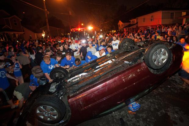 Kentucky fans helped turn a car back onto its wheels on State Street after it had been flipped over by others during Saturday night's celebration. Police said there were several arrests.