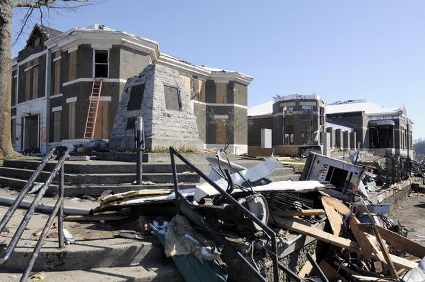 The century-old Morgan County Courthouse, left, in West Liberty was heavily damaged by the tornado Friday, as was the unfinished new justice center being built behind it