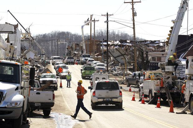 Downtown West Liberty was full of activity Tuesday amid the devastation as repair work continued. Residents and business owners were allowed into the area for the first time since Friday's storm