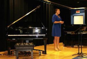 UK Vocal Major Rebecca Farley sings along to a new Yamaha Disklavier Piano. 18 of the instruments were delivered to the UK School of Music this week.