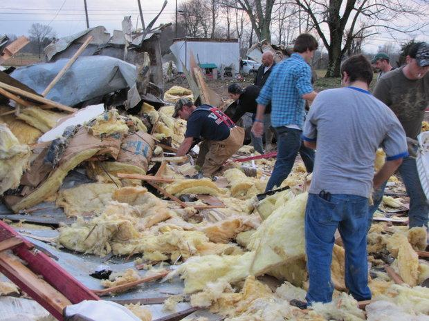 Volunteers helped clear debris and look for salvageable belongings in what was once a mobile home owned by Aaron Keith. The mobile home was destroyed 2/29/2012 when a suspected tornado moved through Russell County.