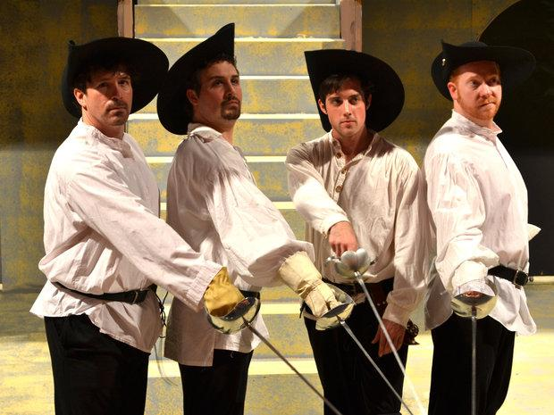 G.B. Dixon, left, Evan Sullivan, Paul DiSilvestro and Jacob Karnes wield swords in The Three Musketeers.