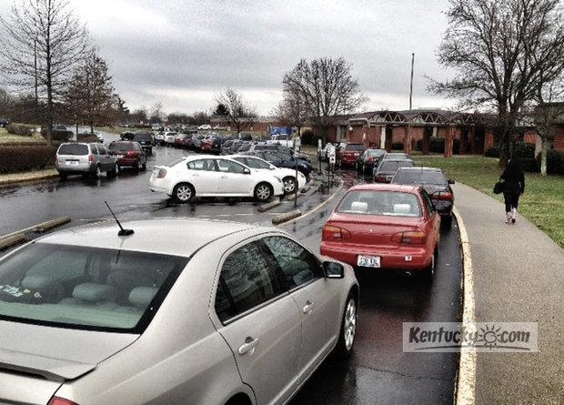 Parents line up to pick their children up from Southern Elementary Friday afternoon after Fayette County Schools decided to close two hours early due the the threat of dangerous storms headed to the area later this afternoon.