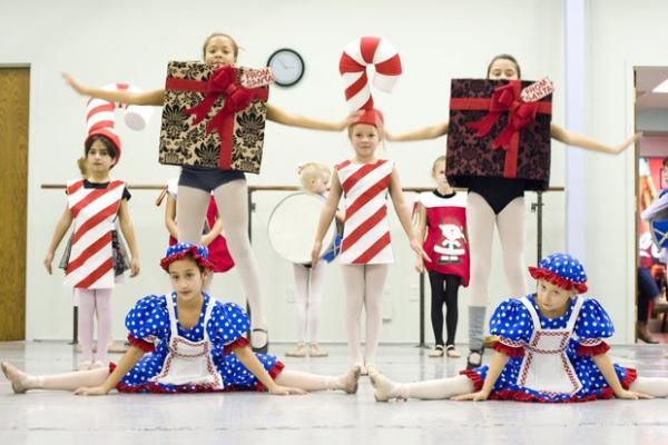 The ballet features Elena V. Munoz Diaz, left, and Hana Johnson as rag dolls; Tajayona Wilson and Belen Pozzolo as boxes; and Shayda Alba Alsalihi and Carmen Everson as candy canes.