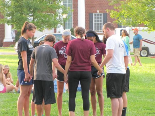 Several hundred people, most of the Campbellsville University students, gathered on the campus on Aug. 21, 2014 for a prayer service after two firefighters were seriously injured earlier in the day in an accident at the school.