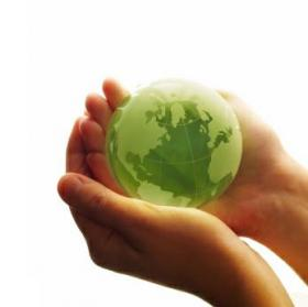A green globe held in cupped palms.