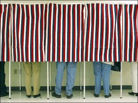 People in a voting booth with a red striped pattern.
