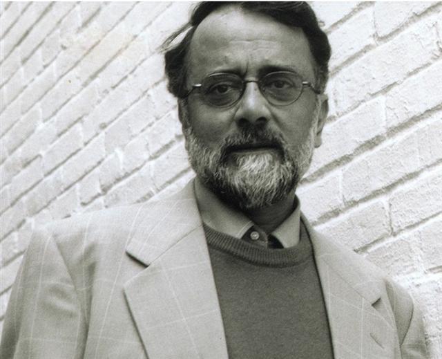 A black and white photo of Ahmed Rashid.