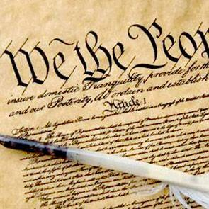 The United States Constitution and a quill pen