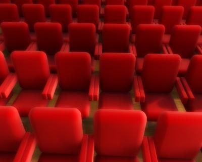 Rows of red movie chairs.