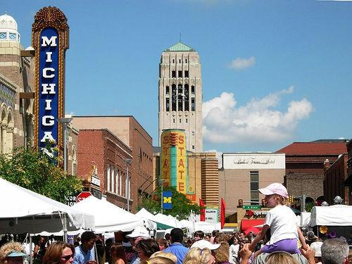 A shot of the Ann Arbor Art Fair with the Michigan Theater in the background.