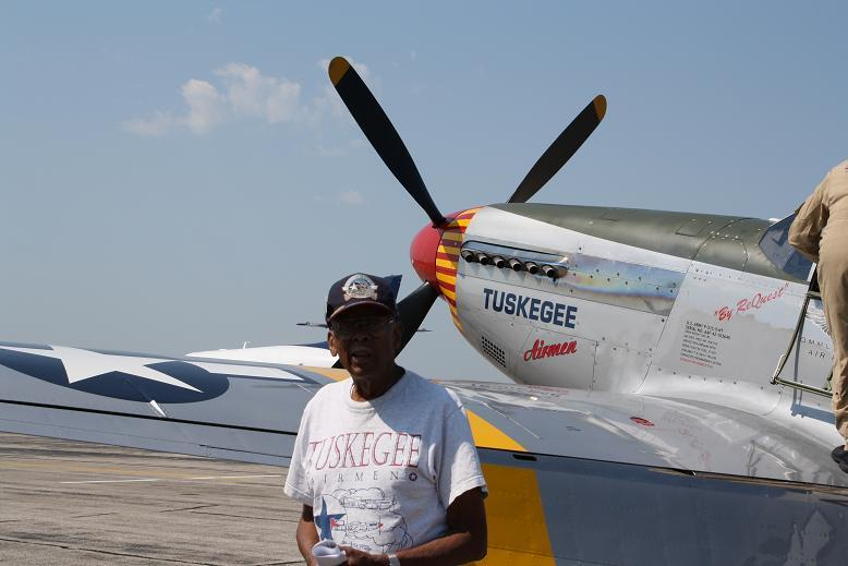 LTC Alexander Jefferson of the Tuskegee Airmen in front of a Red Tail P-51 Mustang fighter.