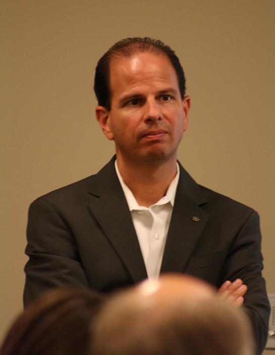 WISD Superintendent Scott Menzel listens to comments on the draft unification plan.