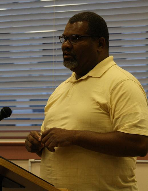 Ypsilanti Housing Commission interim Executive Director Eric Temple answers questions from city council.