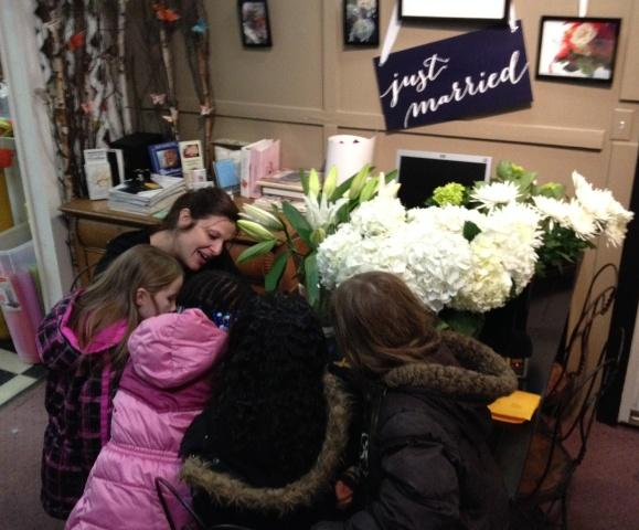 Kids gather around Enchanted Florist owner Laura Lanzon.