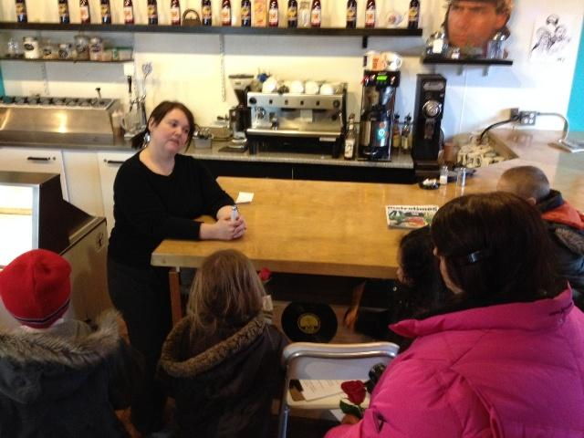 Cafe' Ollie owner Danielle Teachout talks with students.