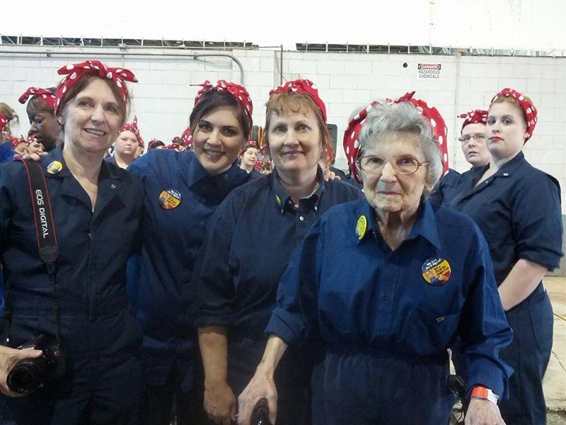 From left to right Hilda Havlik, Christy Hoffman, Deb Hoffman, and Betty Jones attended the successful record-breaking event at the Willow Run Bomber Plan for the largest gathering of people dressed as Rosie Riveter.