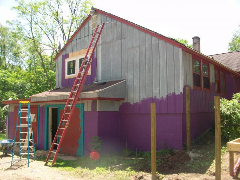 Painting the outside of MISSION's house in Ann Arbor