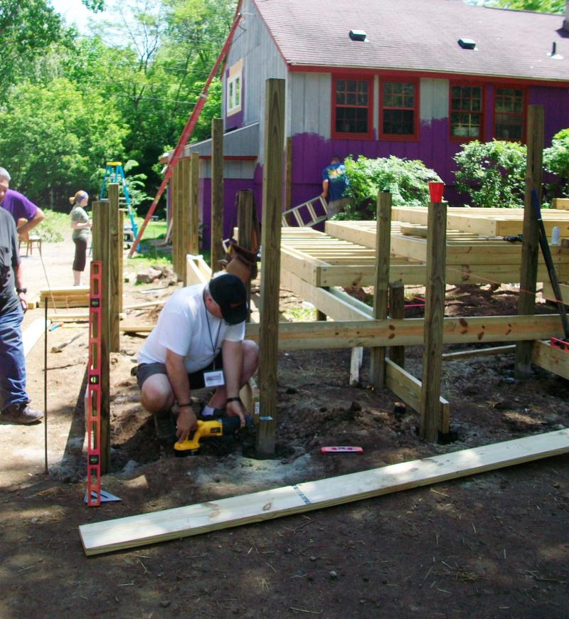 Volunteers from area Presbyterian Churches help build a deck at MISSION's house in Ann Arbor