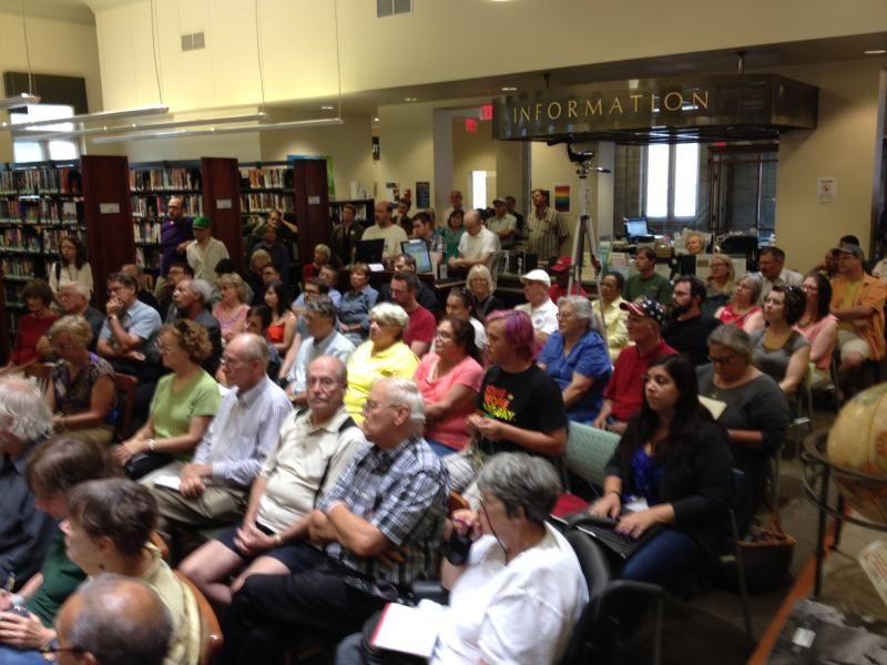 A large crowd listens to the Ypsilanti mayoral candidates at the downtown branch of the Ypsilanti District Library.