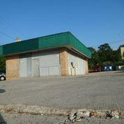 Former gas station on Broadway with leaking underground storage tanks