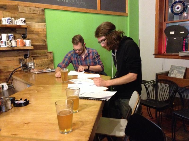 Cast members study scripts.