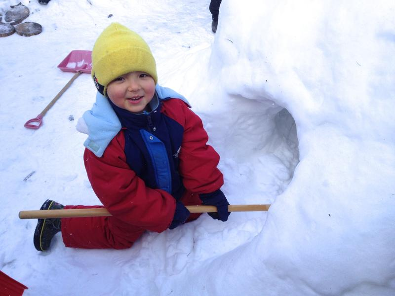Hollowing out the snow cave at Blssom Home Preschool