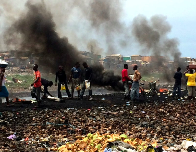 Burning tires to process e-waste in Agbogbloshie, Ghana