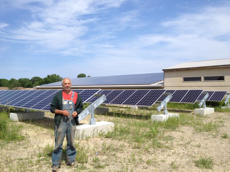 Richard Andres with the solar arrays at the Washtenaw Food Hub.