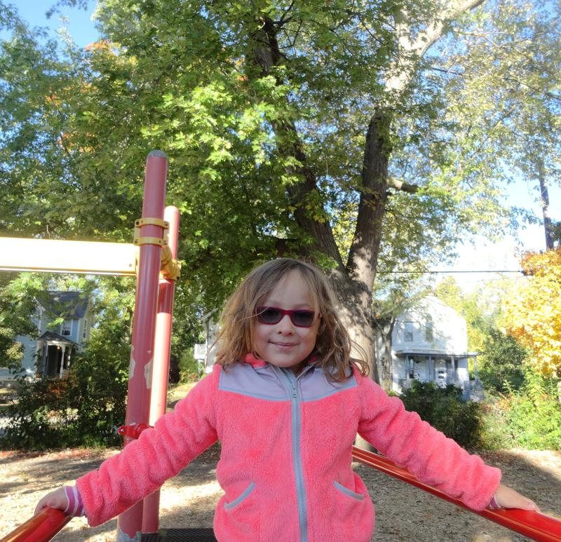 "Bach Elementary student Eva Borgsdorf in front of the ""owl tree"""