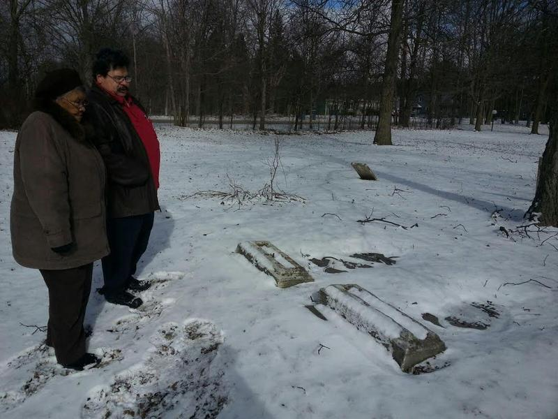 Les Jackson and Alice Jackson Gilbert stand next to Asher and Catherine Aray's headstones at Hardwood Cemetery in Pittsfield Township.