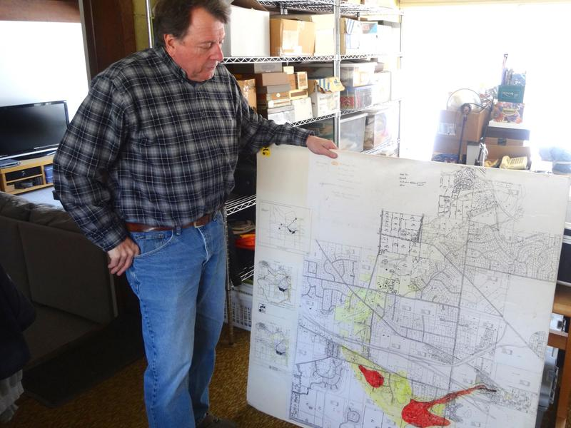 Roger Rayle with a decades old plume map
