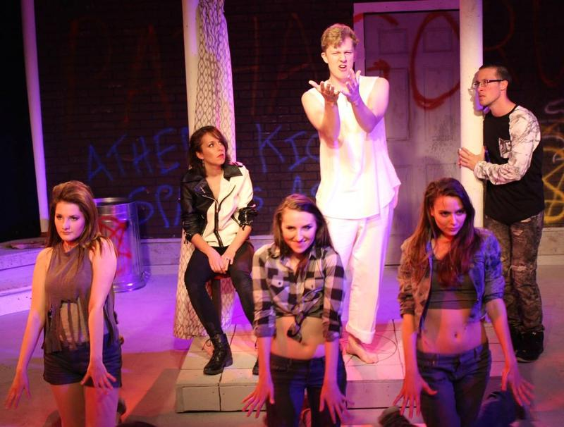 """Performers on stage for the rock musical """"Irrational."""""""