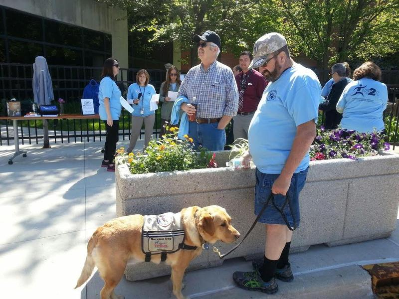 Veteran Rodney Gouine and his service dog Dusty.