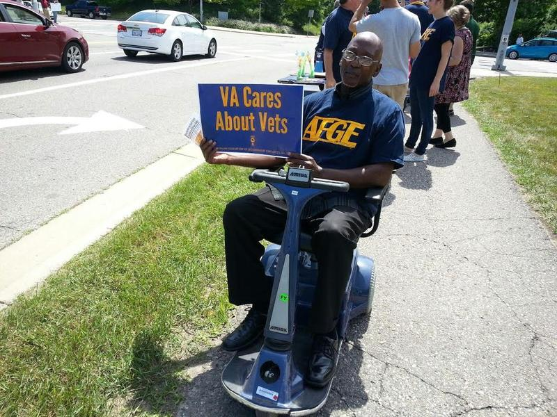 Army veteran Calvin Johnson shows his support by holding a sign.