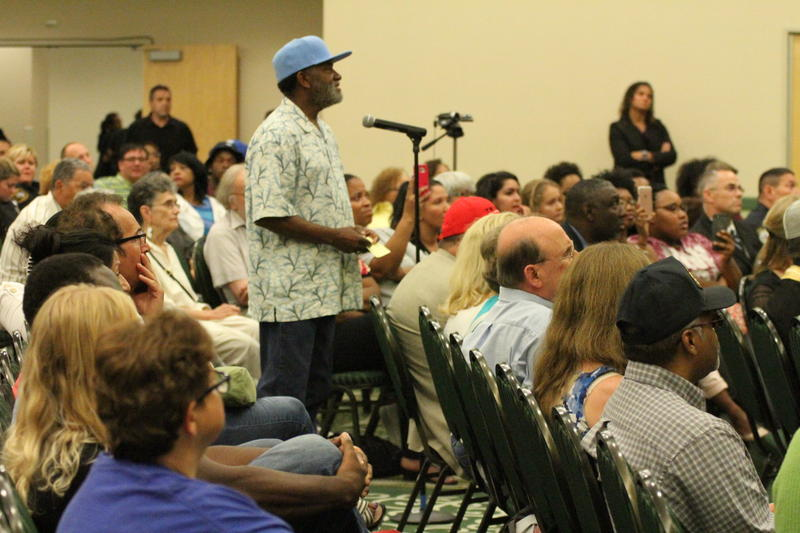 A audience member asks a question to the panel.