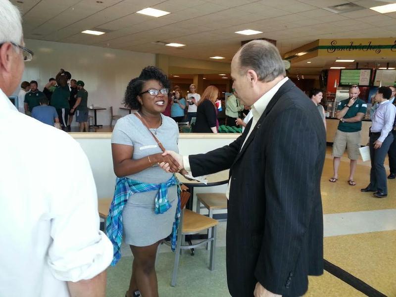 President James Smith speaks with EMU's student body president Tanasia Morton.