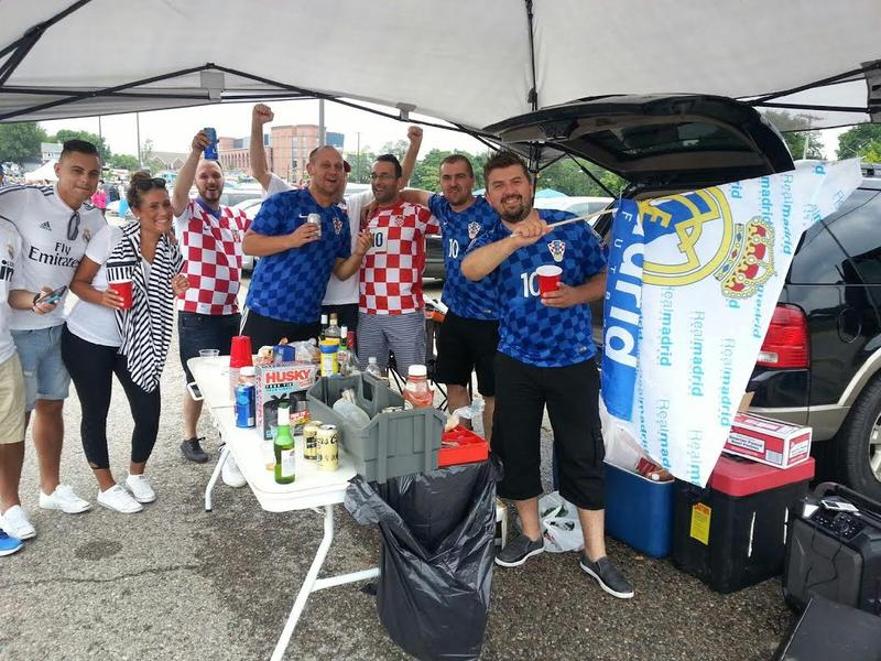 A mix of general soccer fans tailgate at Michigan Stadium.